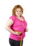 Cintura de medição da mulher gorda fotografia de stock royalty free