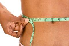 Cintura de medición, cierre para arriba del abdomen étnico de la mujer Foto de archivo libre de regalías