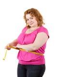 Cintura de medición de la mujer gorda Foto de archivo libre de regalías
