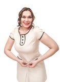 Cintura de medición de la mujer hermosa del tamaño extra grande Fotos de archivo libres de regalías