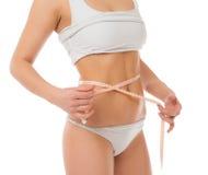 Cintura de medición del concepto de la pérdida de peso de Dietting con cinta métrica Foto de archivo libre de regalías