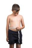 Cintura de medición del muchacho Fotografía de archivo libre de regalías