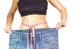 Cintura delgada que adelgaza dieta acertada del cuerpo fotografía de archivo
