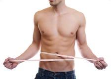 Cintura measuing del hombre muscular Fotografía de archivo libre de regalías