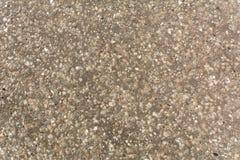 Cinza granulado do detalhe da rua textured foto de stock
