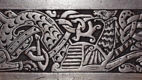 Cinzeladura de madeira de Viking de um grifo Fotografia de Stock Royalty Free