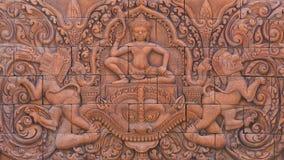 Cinzeladura de pedra da cultura na parede fotografia de stock