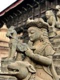 Cinzeladura de pedra do templo do Nepali Foto de Stock Royalty Free