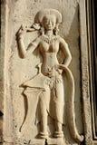 Cinzeladura de pedra dos dançarinos de Apsara, em Camboja imagens de stock royalty free