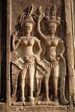 Cinzeladura de pedra dos dançarinos de Apsara, em Camboja imagens de stock