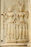 Cinzeladura de pedra dos dançarinos de Apsara, em Camboja Foto de Stock Royalty Free