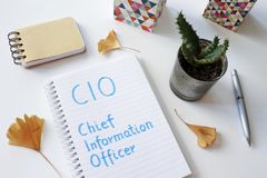 CIO Chief Information Officer written in notebook. On white table royalty free stock photography