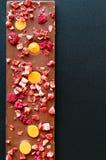 Cioccolato al latte dell'arancia, della fragola e del lampone Immagini Stock