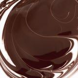 Cioccolato astratto del fondo, e latte caldi e fusa Fotografia Stock Libera da Diritti