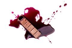 Cioccolato con la sgocciolatura del sangue Fotografie Stock