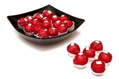 Cioccolato in coperchio rosso Fotografie Stock Libere da Diritti