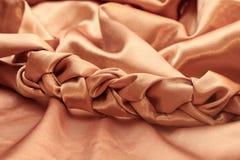 Cioccolato di seta del tessuto dell'oro tessuto treccia fotografie stock