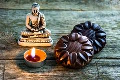 Cioccolato e Buddha naturali Fotografia Stock