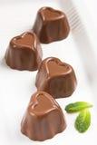 Cioccolato a forma di del cuore Immagini Stock