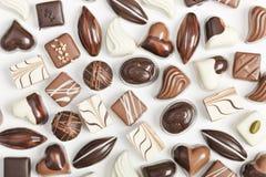 Cioccolato su priorità bassa bianca Fotografie Stock