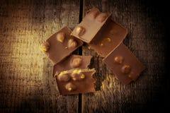 Cioccolato su una tavola di legno Immagini Stock Libere da Diritti