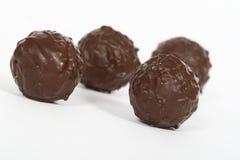 Cioccolato sul primo piano bianco Immagini Stock Libere da Diritti