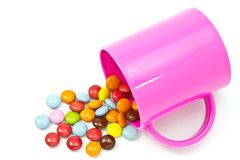 Cioccolato variopinto e tazza Fotografia Stock