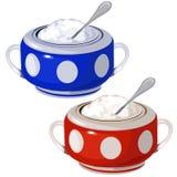 Ciotola blu e rossa della porcellana con il cucchiaio isolato Fotografia Stock