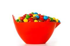 Ciotola con i dolci variopinti del cioccolato fotografia stock