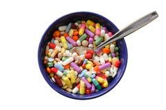 Ciotola con le pillole Immagini Stock