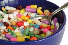 Ciotola con le pillole Fotografie Stock