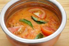 Ciotola del curry del pomodoro fotografia stock libera da diritti