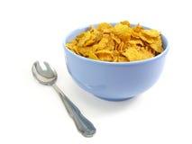 Ciotola di cereale con il cucchiaio immagine stock