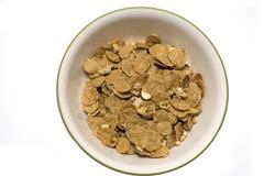 Ciotola di cereale su bianco Immagini Stock