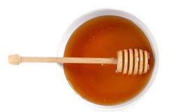 Ciotola di miele ambrato Fotografie Stock