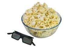 Ciotola di popcorn e di vetri 3d Fotografia Stock