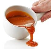 Ciotola di salsa fusa del caramello Fotografia Stock Libera da Diritti