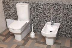Ciotola e bidet di toilette bianchi in wc immagini stock