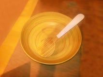 Ciotola e cucchiaio di legno Immagine Stock