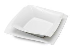 Ciotola e piatto di ceramica bianchi quadrati fotografia stock libera da diritti