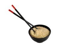 Ciotola in pieno di riso e di bacchette Fotografia Stock Libera da Diritti