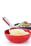 Ciotole di riso grezzo Immagini Stock