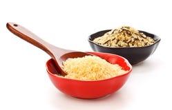 Ciotole di riso grezzo Fotografie Stock
