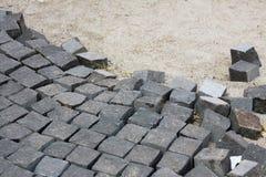 Ciottoli per la pavimentazione di strada di pietra immagini stock