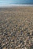 Ciottoli su un litorale di mare Immagini Stock