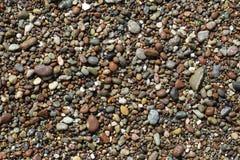 Ciottoli su una spiaggia fotografie stock