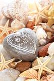 Ciottolo a forma di del cuore Fotografia Stock