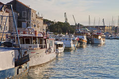 Ciovo, Croatia- touristic and fisher boats moored at pier Stock Photo