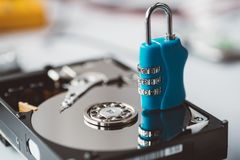 Cipher padlock on opened hard disk. Stock Images