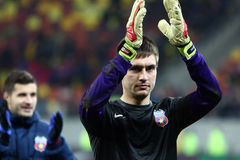 FC Steaua Bucharest- FC Gaz Metan Medias. Ciprian Tatarusanu applauding the supporters, at the end of the football match, counting for the Romanian League One Stock Photography